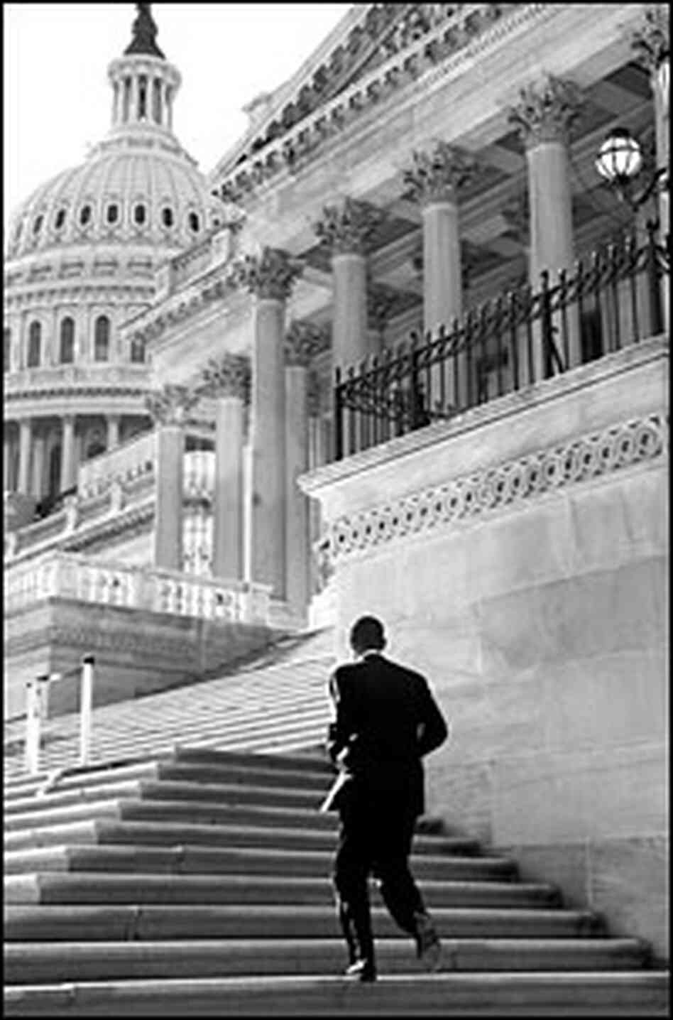 Sen. Barack Obama walks up the steps of the U.S. Capitol.
