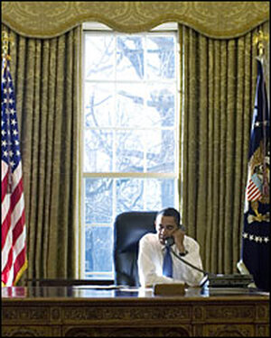 President Obama talks on the phone in the Oval Office on Wednesday