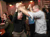 In a scene that may recall St. Patrick's Day revelry, New Yorkers celebrate the Super Bowl in a bar.