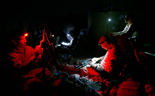 Marines clean their weapons.