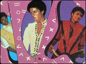 Three Michael Jackson trading cards.