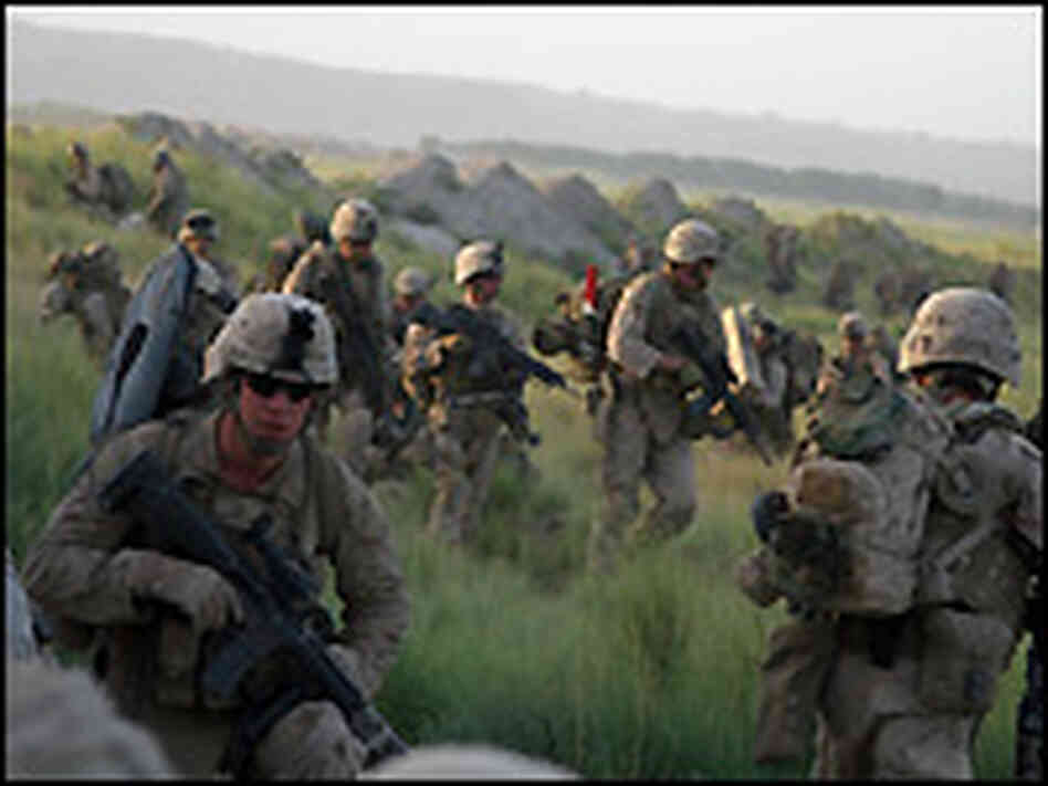 Marines from Fox Company move to their positions.
