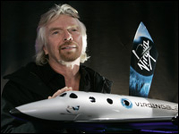 Sir Richard Branson, founder of Virgin Galactic, with a model of the Spaceship Two.  Virgin Galactic will attempt to launch paying customers into sub-orbital space flights with the spacecraft. (AFP/Getty Images)