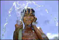 A Cambodian boy cooling himself down