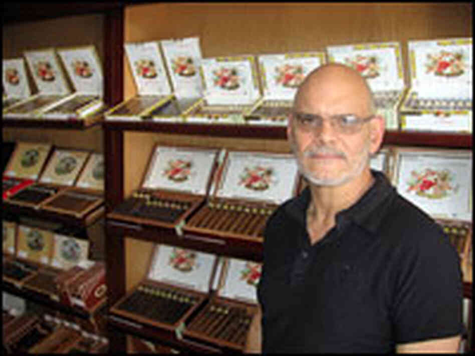 Ernesto Perez-Carrillo stands with the product that made him famous: his La Gloria Cubana cigars.