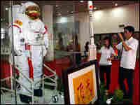 Visitors look at a spacesuit used by astronaut Zhai Zhigang.