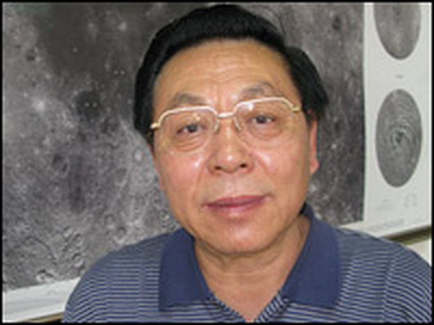Ouyang Ziyuan, the lead scientist with China's Lunar Exploration Program, in his office at the Chinese Academy of Sciences. Behind him is a map of the moon's surface, taken by the Chang'e 1 lunar orbiter and released last year.