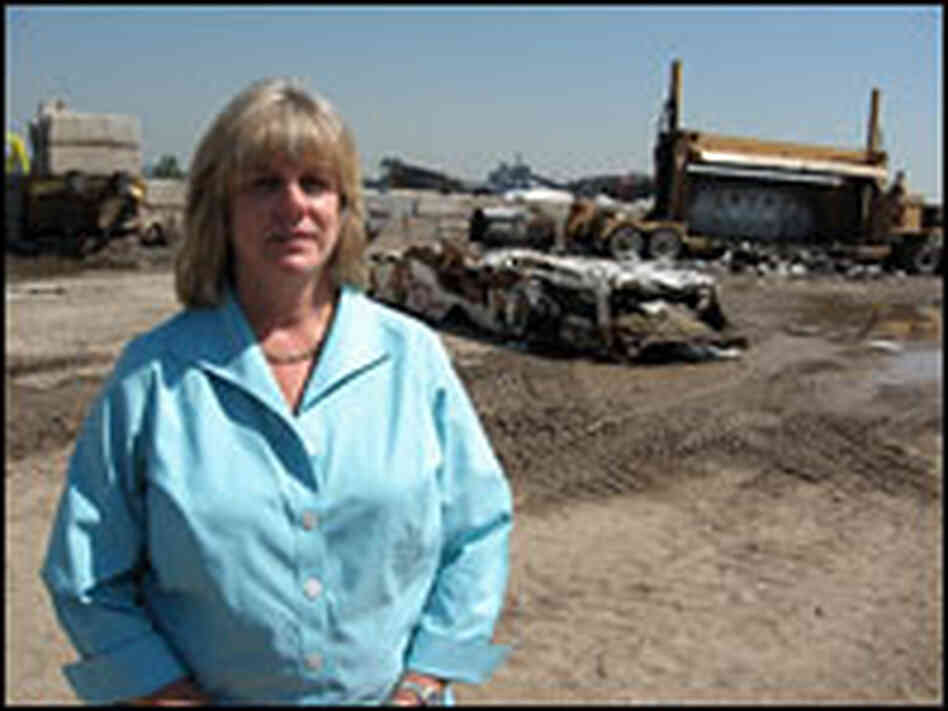 Wrecking yard owner Alice Corns pictured in July in front of a car crusher.