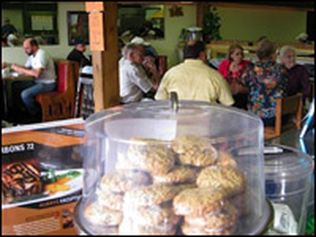 Patrons of The Front Porch cafe in Ellsworth, Mich. When the economic downturn hit the town, its 500 residents needed a gathering place, so a local church gave them one.