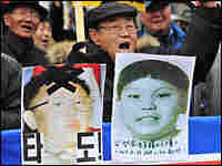 Photos of North Korean leader Kim Jong Il (left) and a boy believed to be his third son and heir