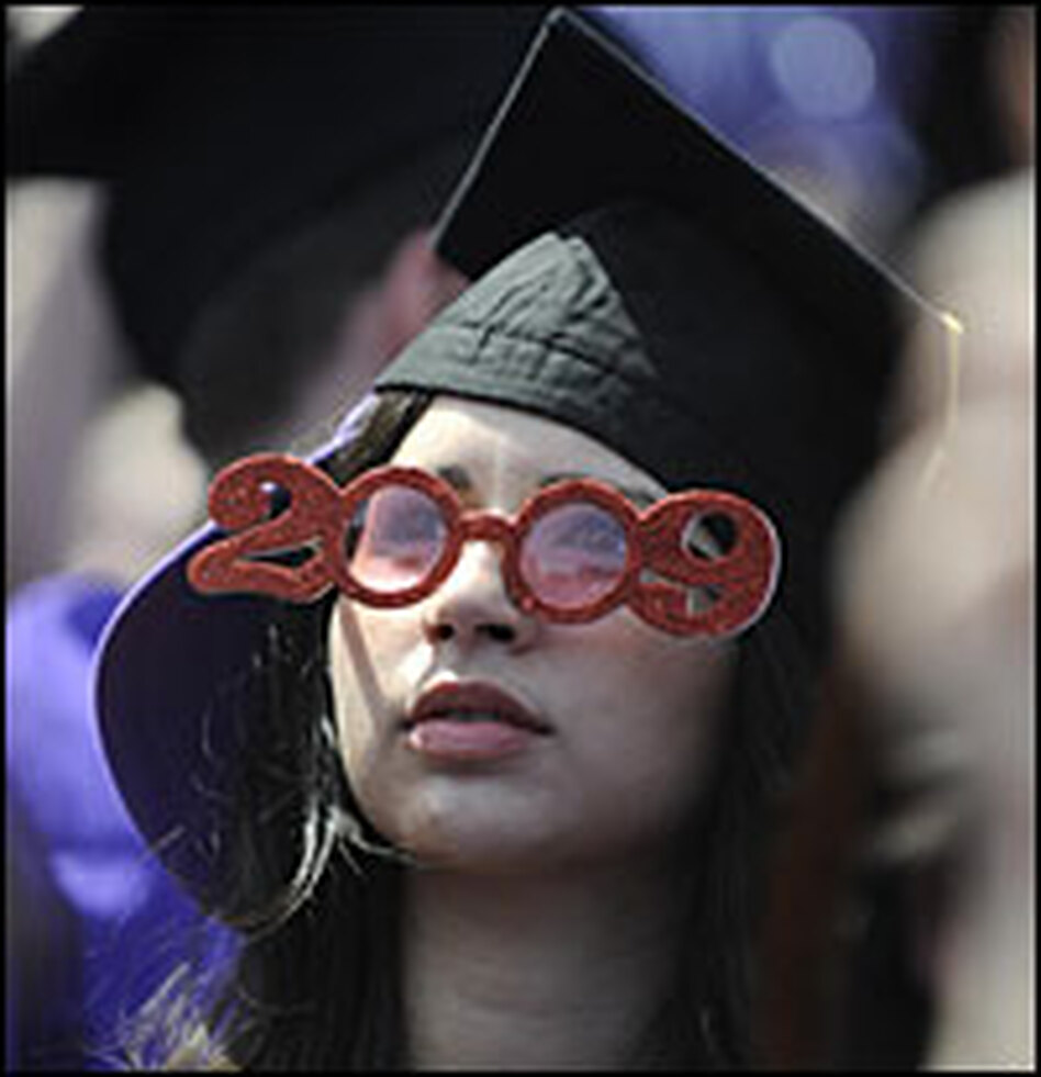 A New York University graduate student attends her graduation in New York this May. Many 2009 graduates are having trouble getting a job in the current recession.