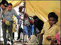 U.S. special envoy Richard Holbrooke enters a tent to meet a displaced Pakistani family.