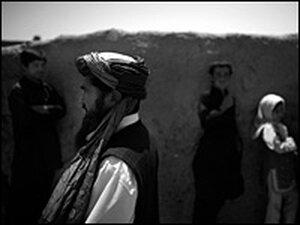 Hadji Abdul Rashid walks through a village where U.S. airstrikes killed up to 90 civilians.