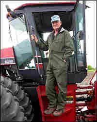 Farmer Linus Solberg climbs into his cultivator in Cylinder, Iowa