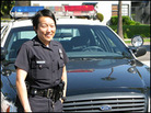 Officer Julie Sohn pictured in front of a patrol car near Koreatown in Los Angeles.