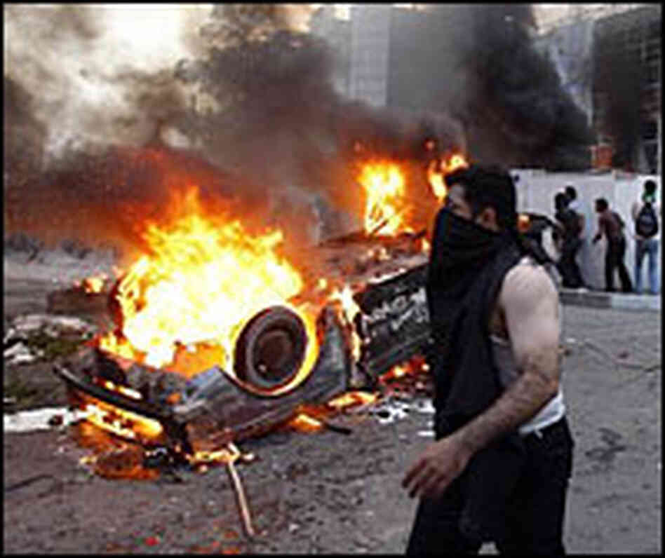 A car burns during protests in Iran.