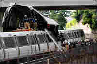 Rescue workers respond to the site of two Metro trains that collided with one another in Washington,