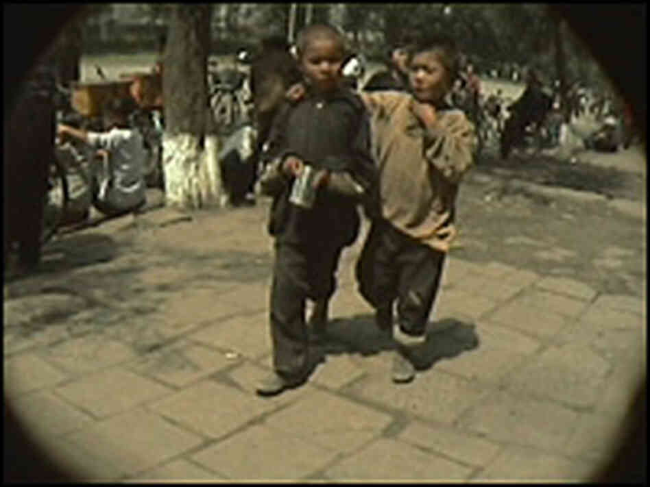 Two street urchins in Chongjin, North Korea