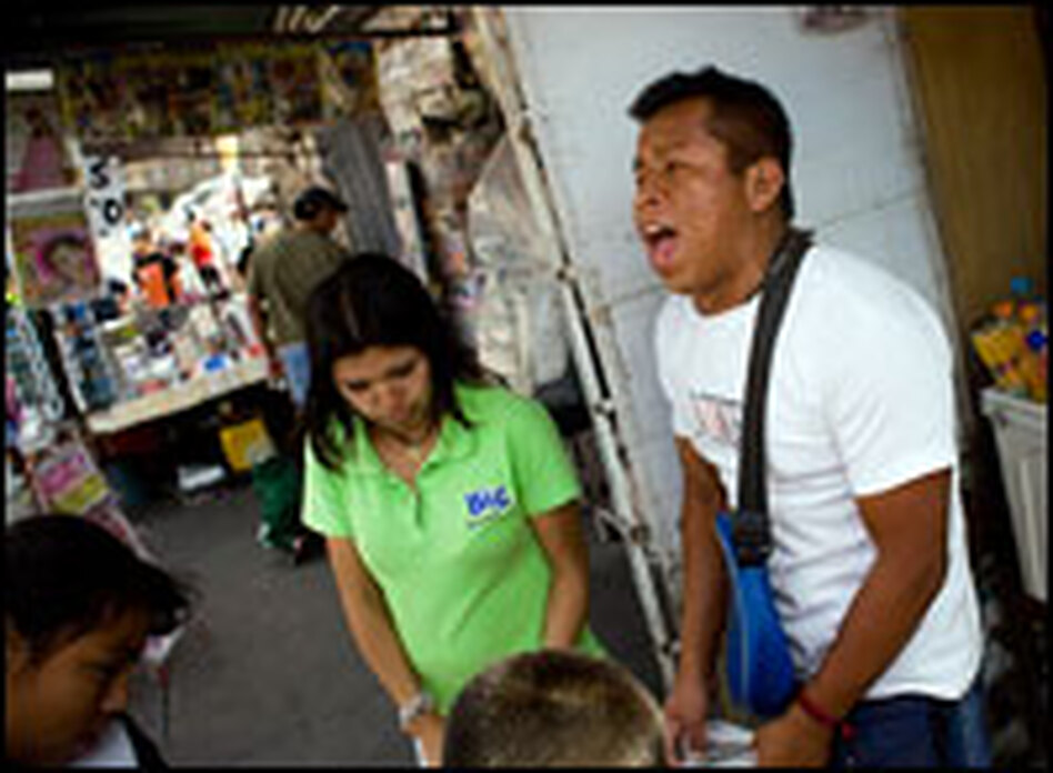 A vendor screams the price of refreshments to passing tourists in central Mexico City.