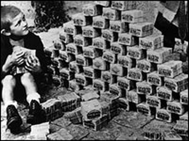 Children use notes of German money as building blocks during the country's inflation crisis in 1923.