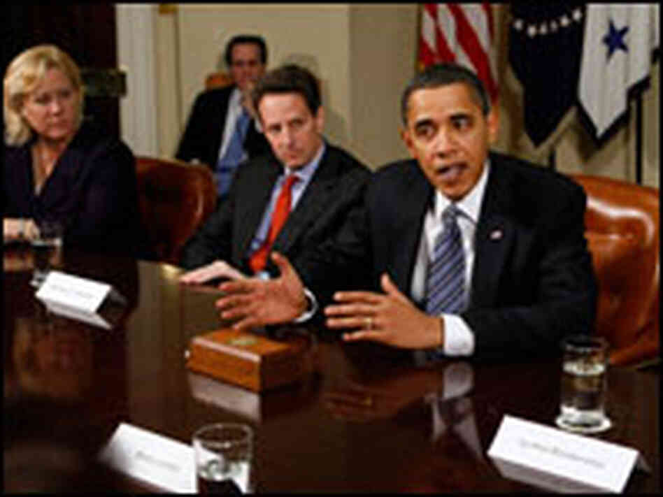 From left: Sen. Mary Landrieu (D-LA), Treasury Secretary Timothy Geithner and President Obama