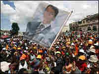 Supporters greet Madagascar leader Andry Rajoelina