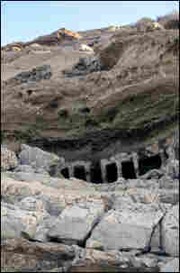 Cliffs that were once submerged now reveal pre-Christian tombs built into the rock face.