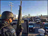 Mexican Federal Police personnel patrol