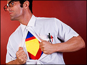A man with taped glasses opens his shirt to reveal a superhero costume underneath.
