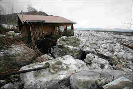 Yukon River ice is packed around a house in Eagle, Alaska, on May 7.