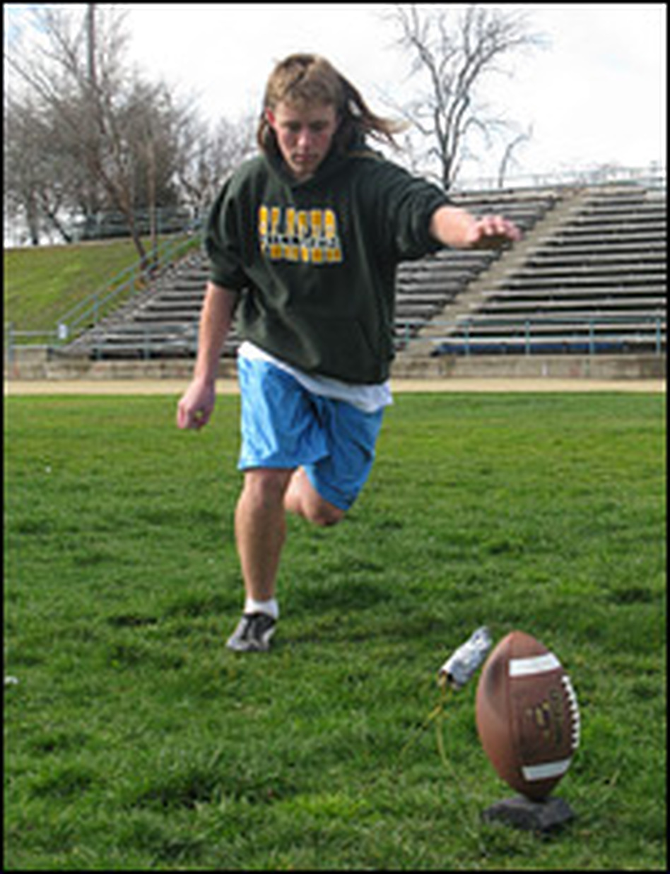 Dominic Granieri, 15, practices kicking at a football field near his home in Meadow Vista, Calif.