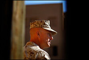 Lt. Col. Christian Cabaniss talks with his troops during a training patrol