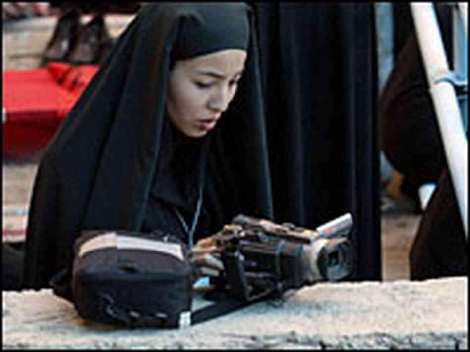 Roxana Saberi videotaping a ceremony in Tehran