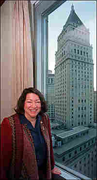 Sonia Sotomayor poses by her office window