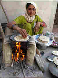 Sharma's daughter-in-law makes chapatis.