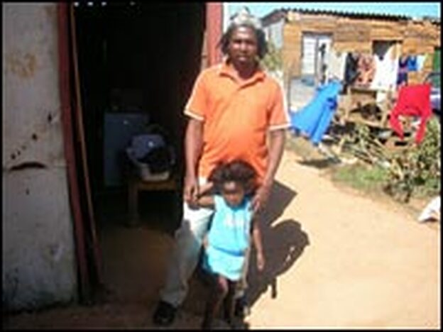 Mbuyiselo Innocent  Klass, head of the Mabuye Land Rights Forum, a group trying to get land rights, and his four-year-old daughter Gugu at home in Zolani.