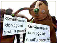 Two environmental activists dress up as snails at the Bali climate change conference.