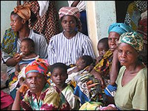 Women wait outside the Egbebiri Health Center in Bayelsa state, Nigeria