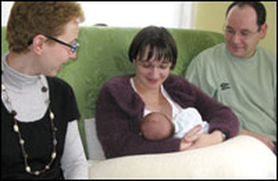 Nurse Nadege Heurtebise visits a young couple and their two-week old baby in Chartres.
