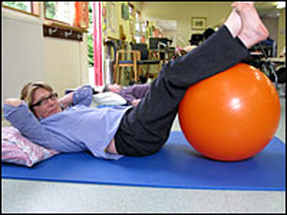 Linda Oatley takes part in a weekly group physical therapy session at the Chilterns MS Centre in Buckinghamshire, England.