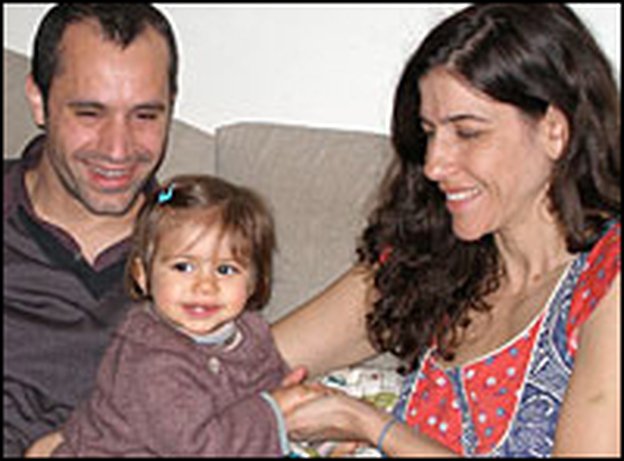 Tanya Blumstein and Tomas Lacronique play with their daughter, Ella.