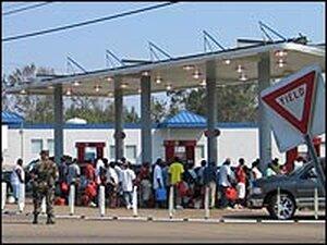 People line up for gasoline in Hattiesburg, Miss.