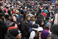 Throngs of people wait in line at a security checkpoint on the National Mall.