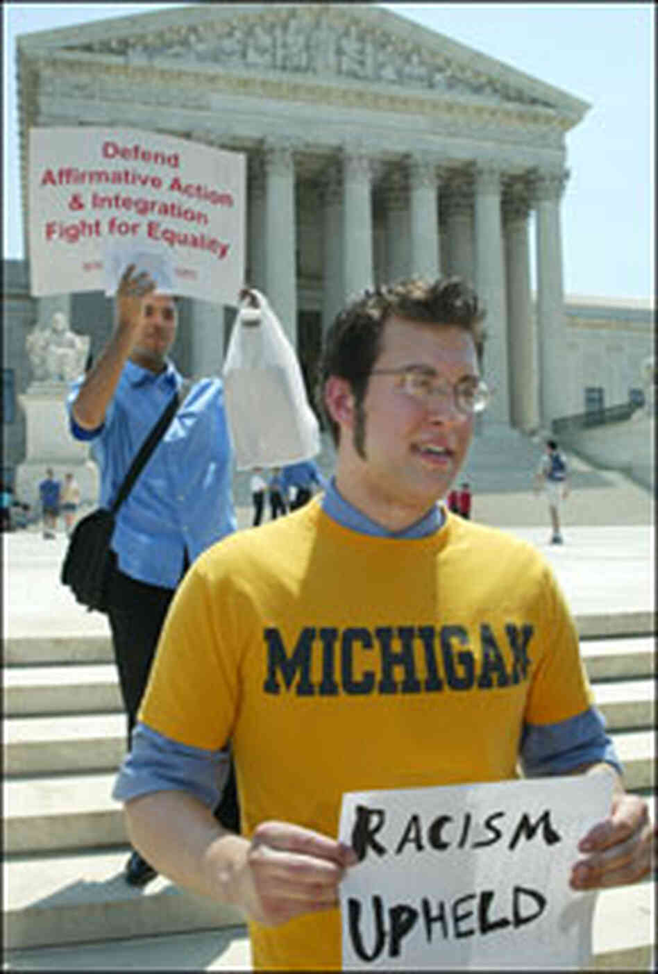 College students hold signs outside the U.S. Supreme Court.