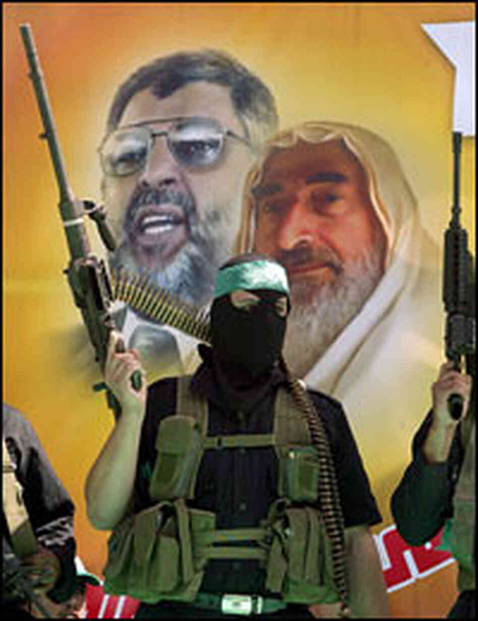 Masked Palestinian members of Hamas take part in a rally to celebrate Israel's pullout from Gaza.
