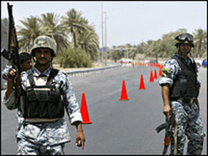Iraqi police commandos stand guard at Baghdad's airport road on July 5.