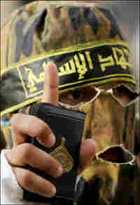 A masked member of the armed wing of the radical Islamic Jihad.