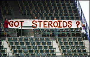 """Fans hold up a sign reading """"Got Steroids?"""" during a 2004 Mets-Giants game."""