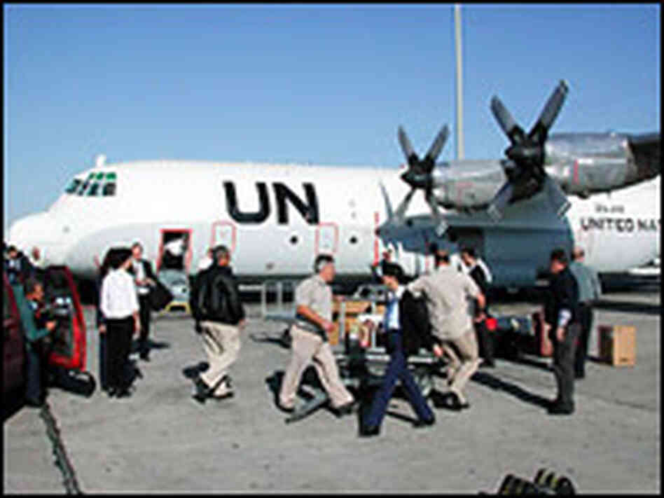 U.N. inspectors deplane in Iraq in Nov. 2002. Credit: Mark Gwozdecky-IAEA.