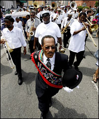 Members of the Algiers Brass Band play in a jazz funeral procession in New Orleans to mark the one-year anniversary of Hurricane Katrina, Aug. 29, 2006.